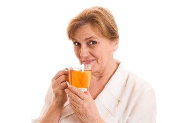 Older woman drinking tea