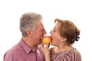 Couple eating an apple