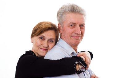 Elderly woman hugging a man