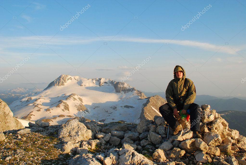Tourist on peak mountain