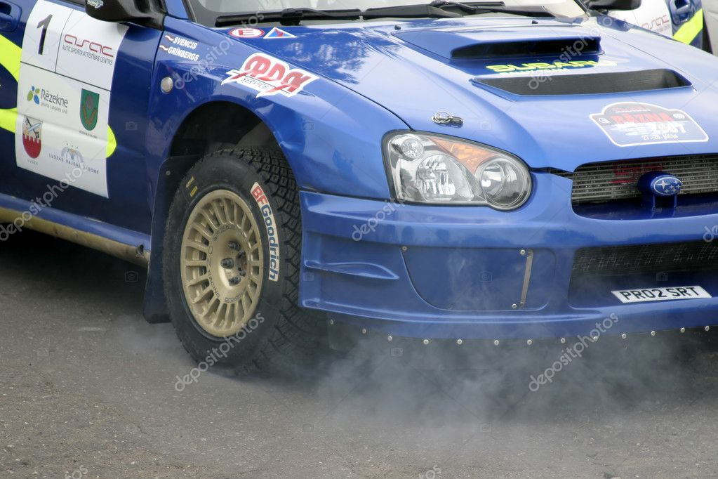 Fuming engine of rally car.