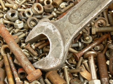 Rusty metal fasteners and wrench