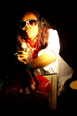 Afro american DJ under yellow-red