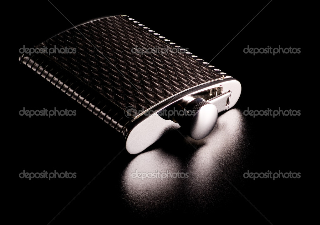 Alcohol grooved flask isolated on black