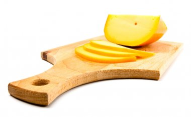 Cheese slices on cutting board