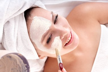 Cosmetician make mask. Facial massage.