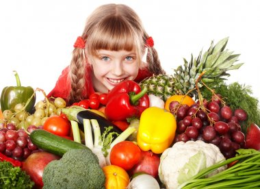 Child girl with vegetable and fruit
