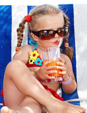 Child girl in sunglasses and red bikini