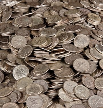 Pile of silver dime coins