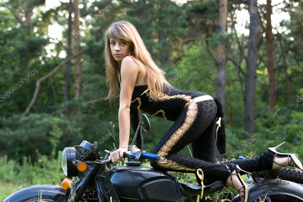 Young women with black motorcycle.