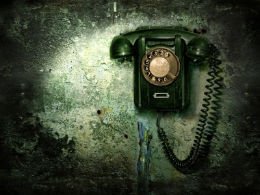 Old phone on the destroyed wall