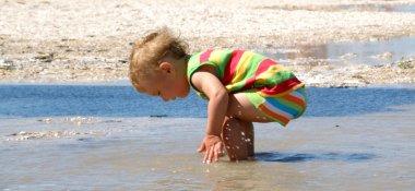The child on sea coast