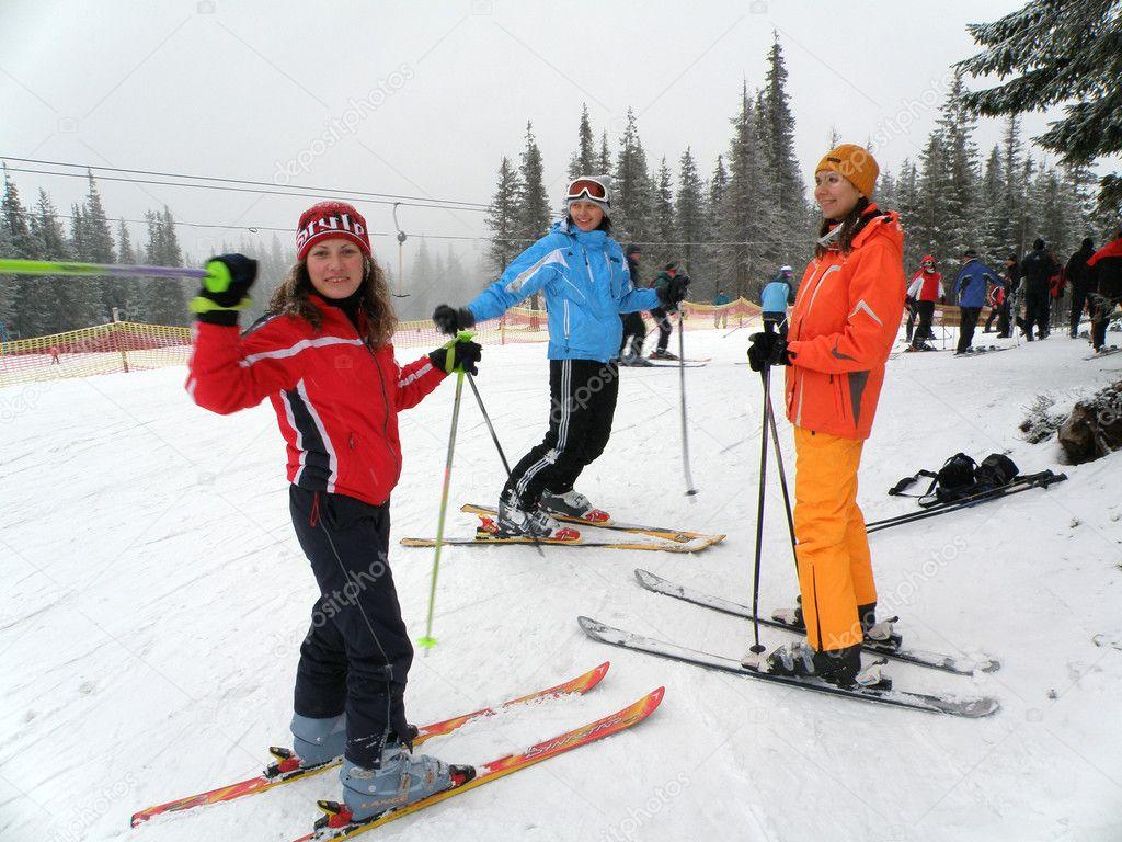 Happy friends on ski resort