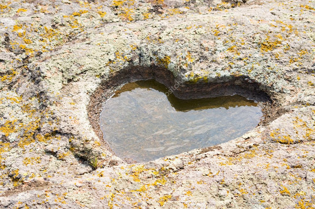 Puddle heart in stone