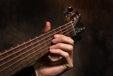 Hand with a guitar