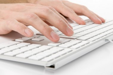 Male hands typing on a keyboard
