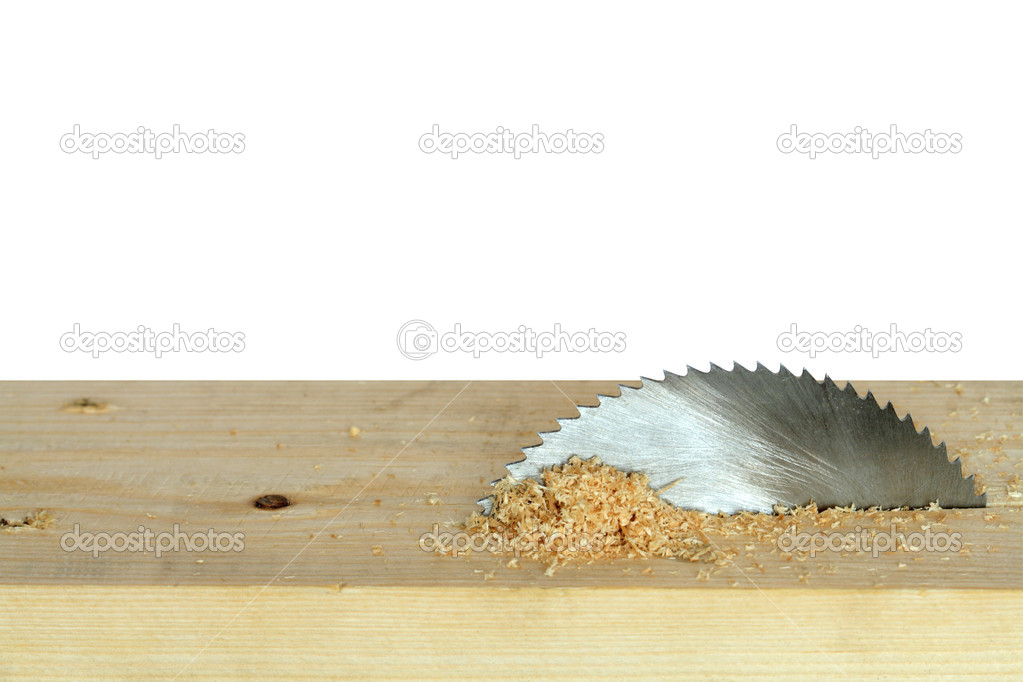 Circular saw cutting wooden plank isolated on white background with clipping path