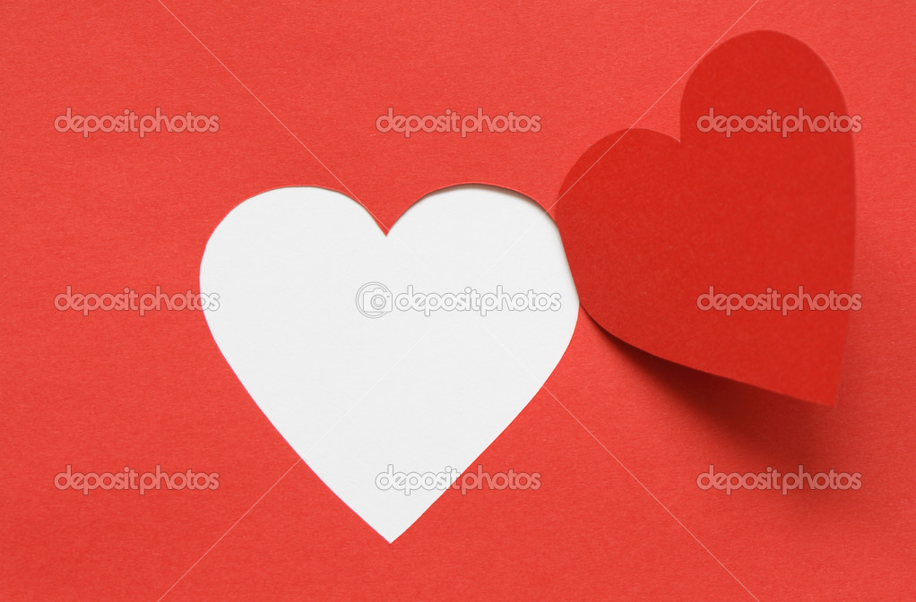 Red paper background with cutting heart. Image with clipping path for your design ideas