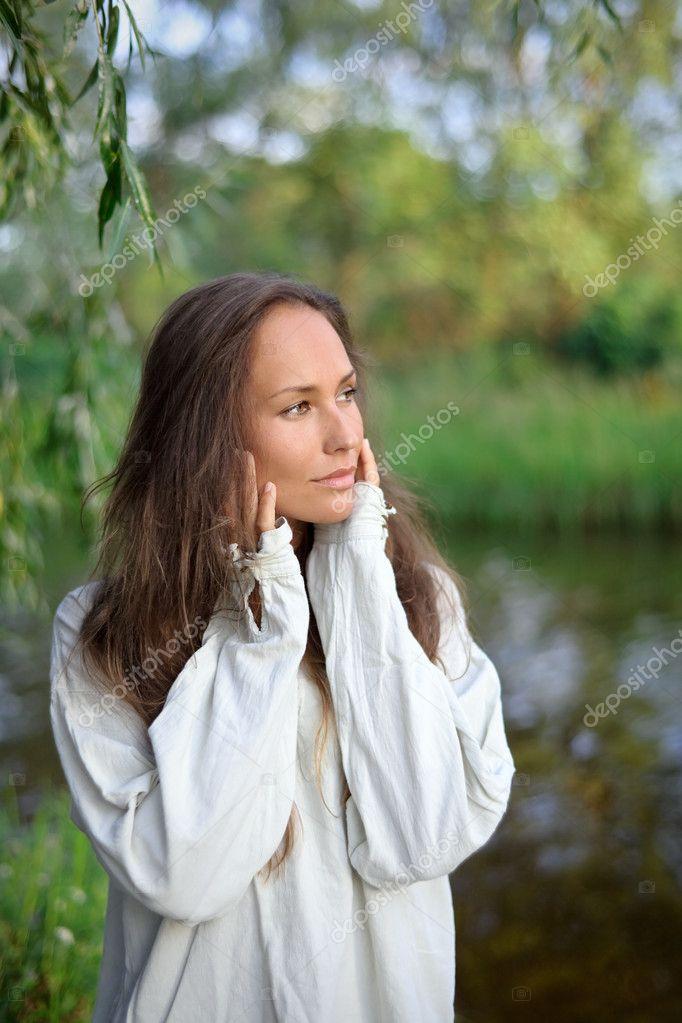 Waiting beautiful young woman outdoor
