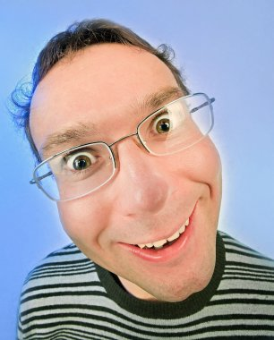 Funny surprised man in glasses portrait