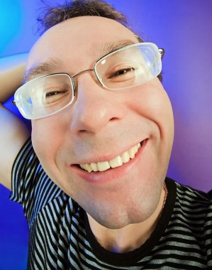 Funny happy man in glasses portrait