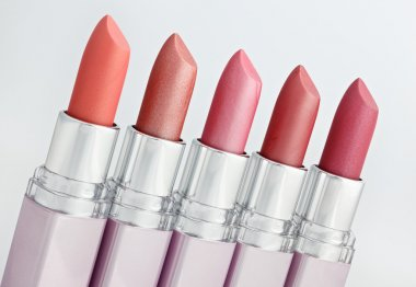Color lipsticks arranged in line macro