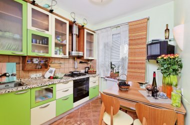Green Kitchen interior with many utensil