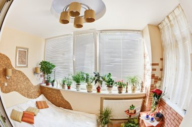 Sunny bedroom on balcony with Window