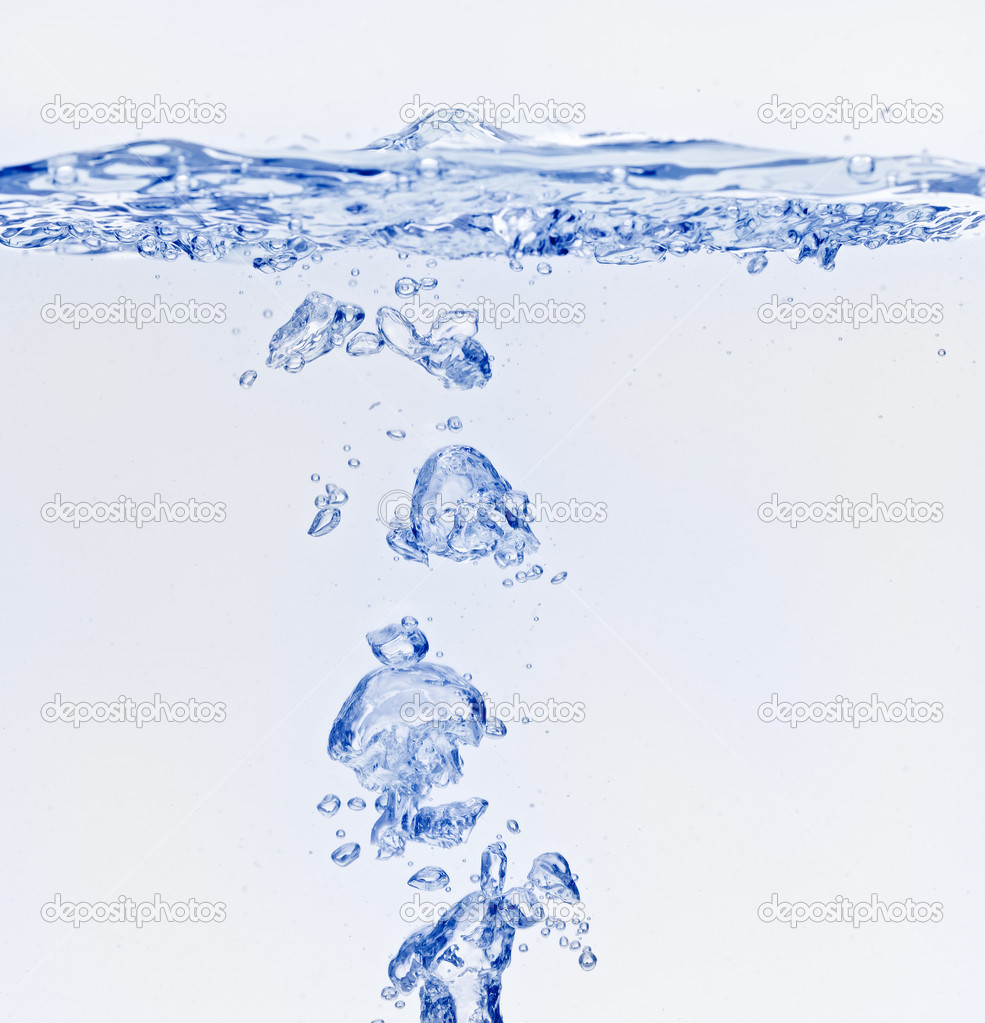 Blue air bubbles under water surface
