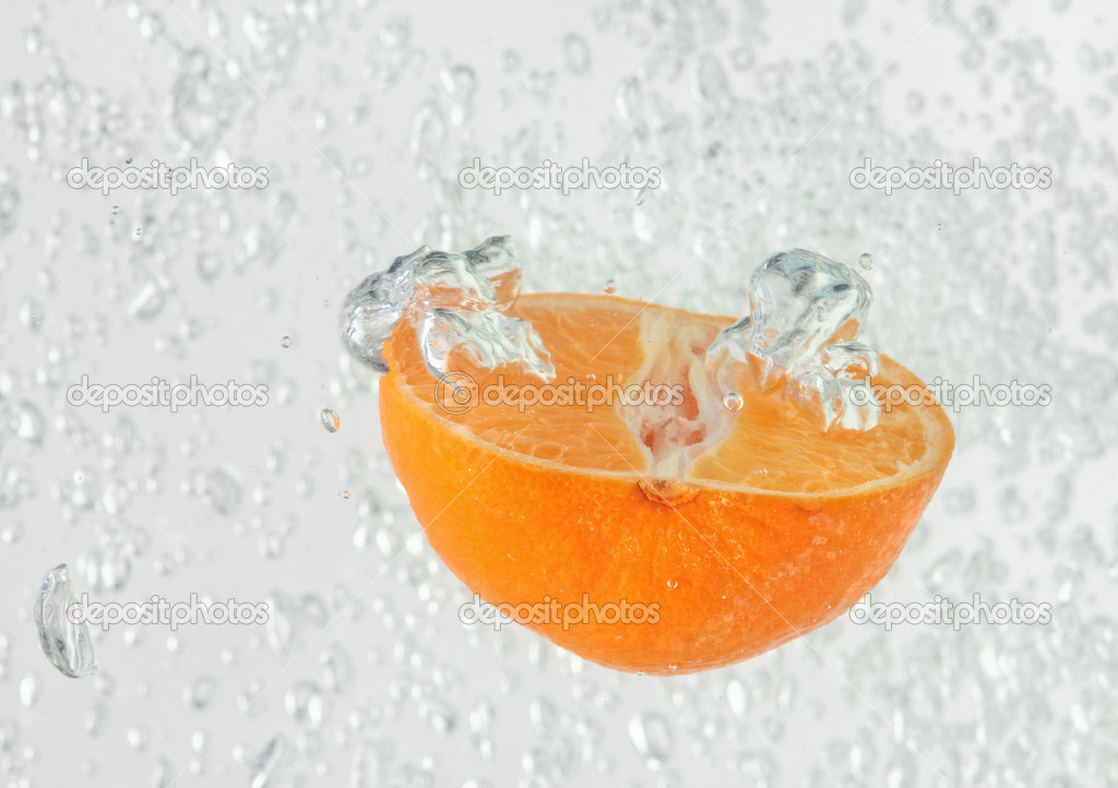 Orange (mandarin) falling in water