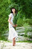 Beautiful girl with herbs