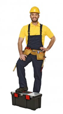 Young manual worker with toolbox