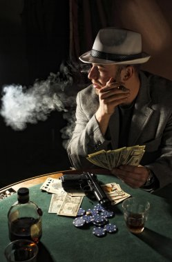 Gangster smoking and play poker
