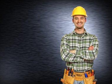 Positive handyman smiling