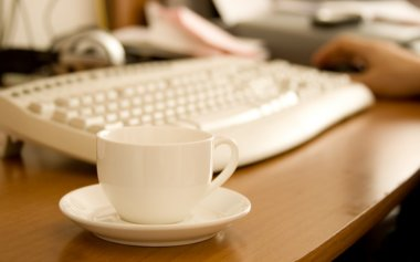 Coffee cup on workplace