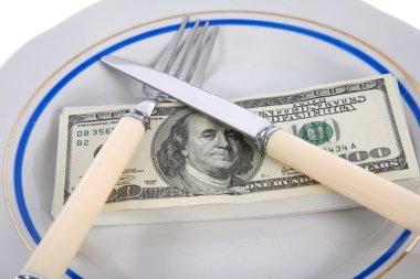 Dollars on food plate