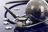 Globe puzzle-kék háttér.