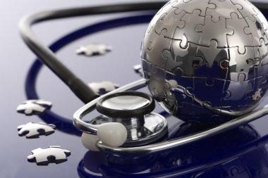 Globe puzzle on blue background.