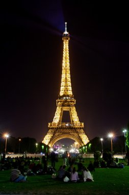 Eiffel tower by night and on the