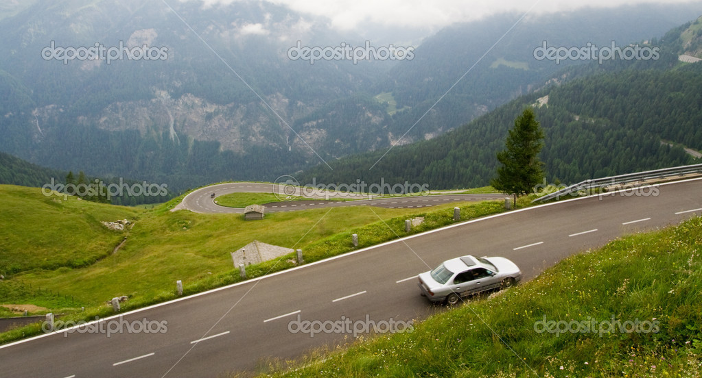 High alpine road with car