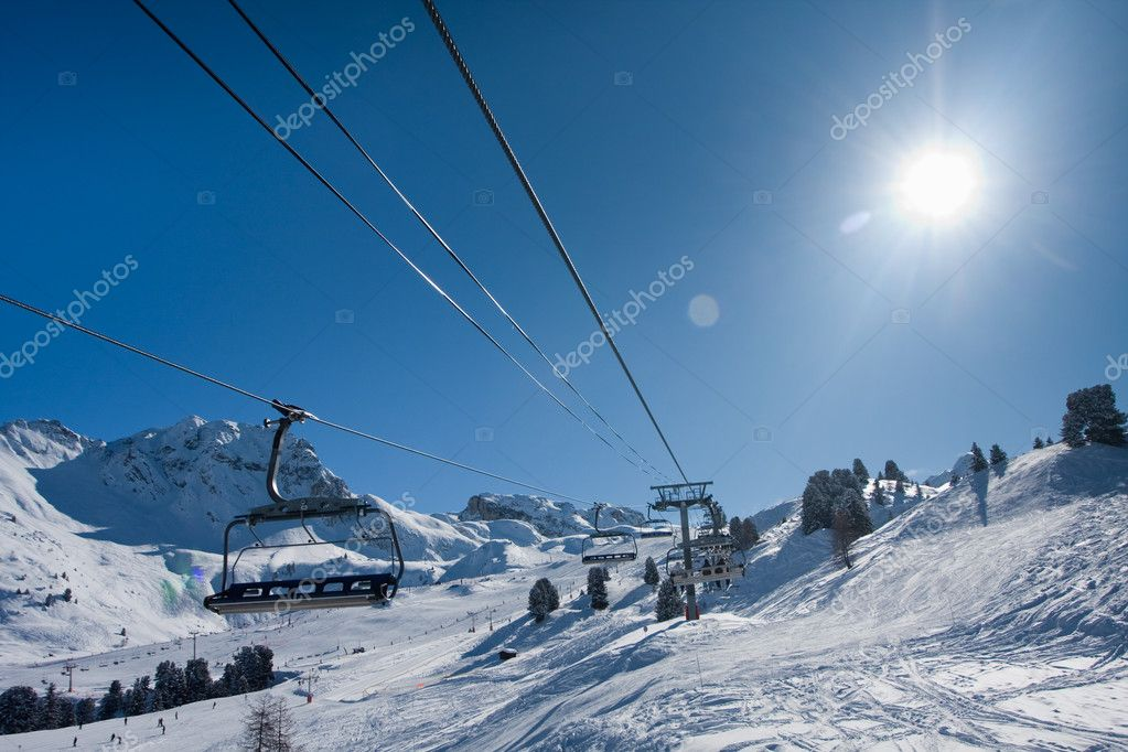 Chairlift on ski resort. Up