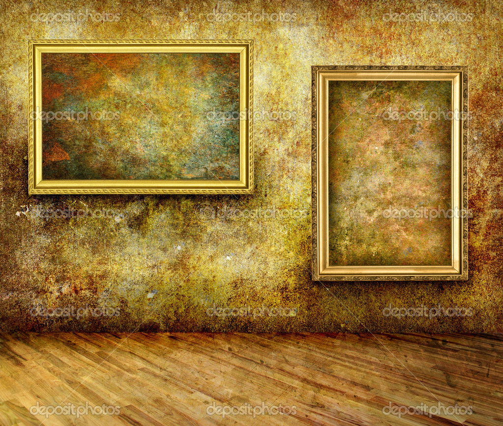 a dark grungy room with gold frames on the wall photo by volokhatiuk - Museum Frames