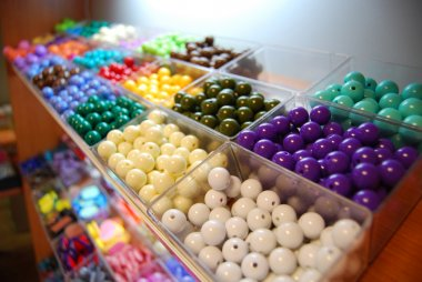 Multicoloured beads in boxes for sale