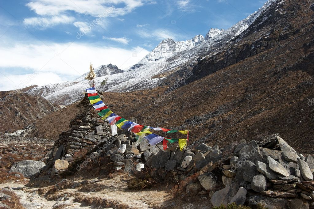 Old stupa with prayer flags