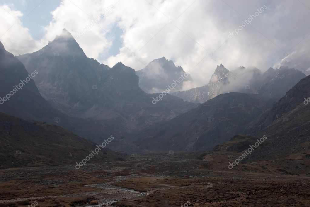 Clouds over rocky mountains, Himalaya, N