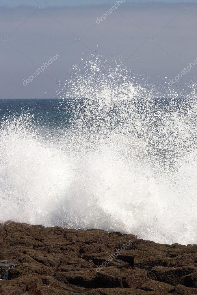 Wave crashing against the shore