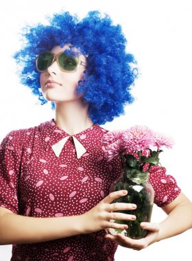 Beauty young woman in a blue wig with fl