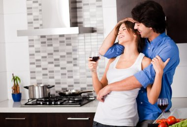Young couple hug in their kitchen