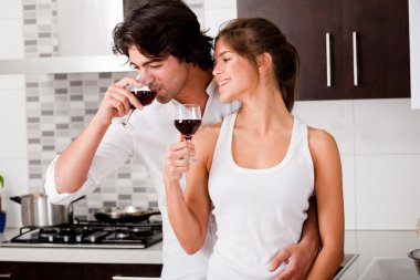 Happy young couple drinking wine