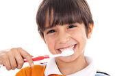 Photo Closeup of cute kid brushing his teeth